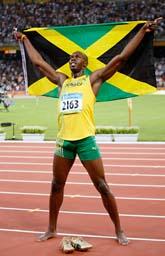 Usain Bolt jublar efter segern på 100 meter i OS. Foto: Robert F. Bukaty/Scanpix