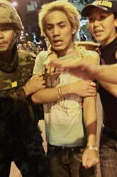 Många skadades av skott från ett granatgevär i Bangkok. Foto: David Gutterfelder/Scanpix