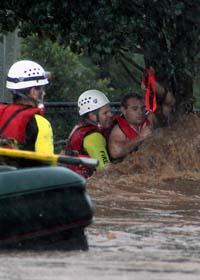Staden Brisbane hotas av översvämningarna. Foto: Patrick Kramer/Scanpix