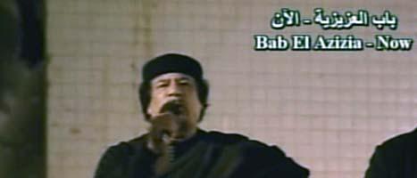 Libyens ledare Muammar Gaddafi håller tal i tv där han hotar med att fortsätta anfalla. Foto: AP/Scanpix