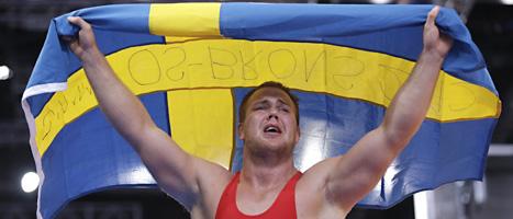 En överlycklig Jimmy Lidberg jublar efter att ha tagit bronsmedaljen i 96-kiloklassen i brottning. FOTO: Paul Sancya/SCANPIX