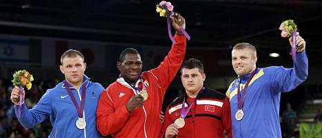 Johan Eurén, längst till höger, vann brons i sitt första OS. FOTO: Paul Sancya/SCANPIX