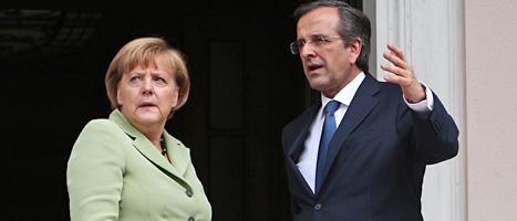 Angela Merkel och Antonis Samaras. Foto: Thanassis Stavrakis/Scanpix.