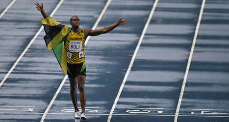Usain Bolt vann finalen på 100 meter. Någon rekordtid blev det inte. Det regnade alldeles för mycket. Bolt vann på 9.77 sekunder. Foto: Martin Meissner/Scanpix