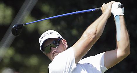 Henrik Stenson ligger bra till för att vinna slutspelet i PGA-touren i golf. Foto: John Bazemore/Scanpix.