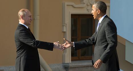 USAs president Obama skakar hand med Rysslands president Putin. Foto: Martinez Monsivais/Scanpix.