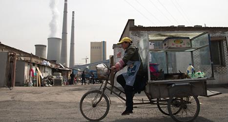Kinas kolkraftverk spyr ut massor av koldioxid. Foto: Andy Wong/TT.