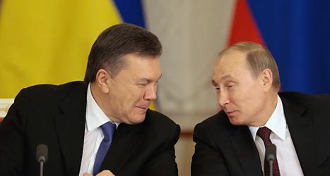 Rysslands ledare Vladimir Putin och Ukrainas ledare Viktor Janukovytj. Foto: Ivan Sekretarev/TT