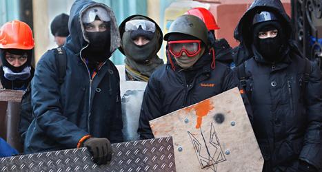 Demonstranter i Kiev i Ukraina. Foto: Sergej Grits/TT.