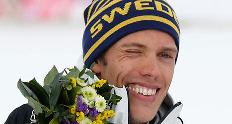 Marcus Hellner med sin OS-medalj. Han blev tvåa i söndagens skiathlon. Foto: Mathias Schrader/TT.