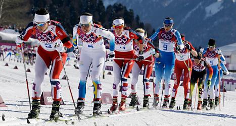 Charlotte Kalla blev tvåa efter Marit Björgen från Norge: Foto: Kirsti Wigglesworth/TT.