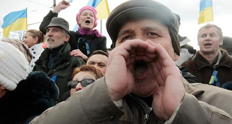De som protesterade fick som de ville. Ukrainas president har tvingats sluta. Foto: Sergei Chuzavkov /AP /TT.