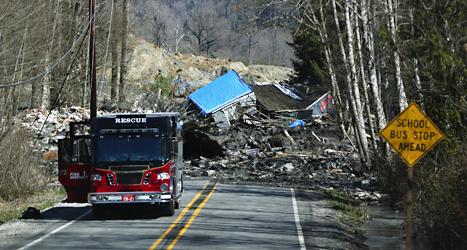 Flera hus har förstörts i ett jordras i USA. Många människor dog. Foto: Lindsey Wasson/AP/TT.