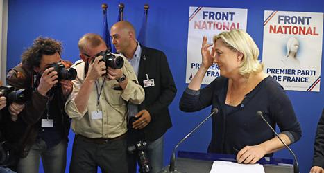 Nationella frontens ledare Marine Le Pen fotograferas efter sin seger i valet. Foto: Remy de la Mauviniere /TT