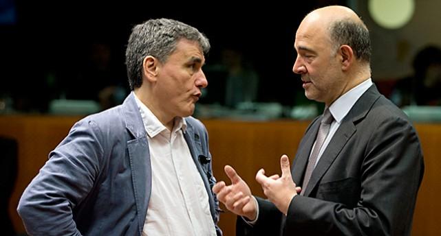 Greklands finansminister och EUs ekonomiminister pratar med varandra.