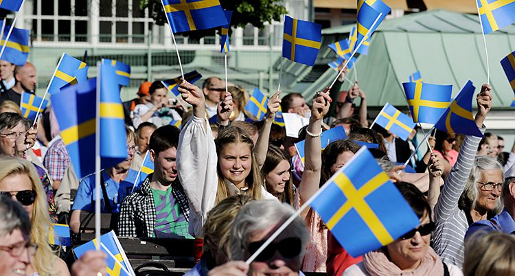 Folk med flaggor