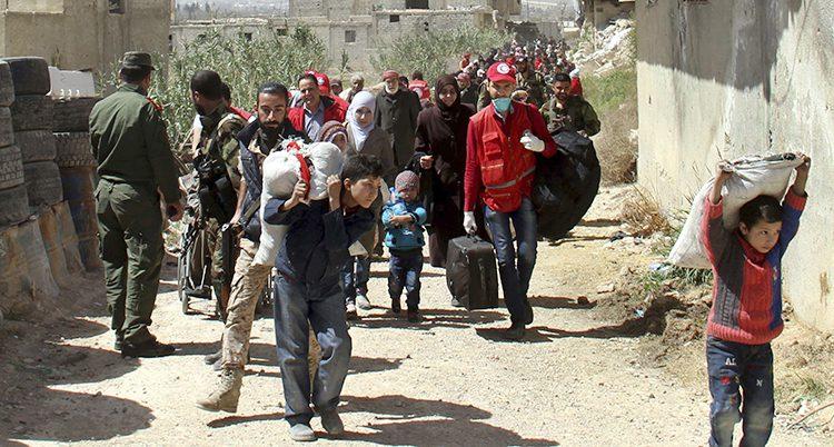 Folk på flykt från området Ghouta