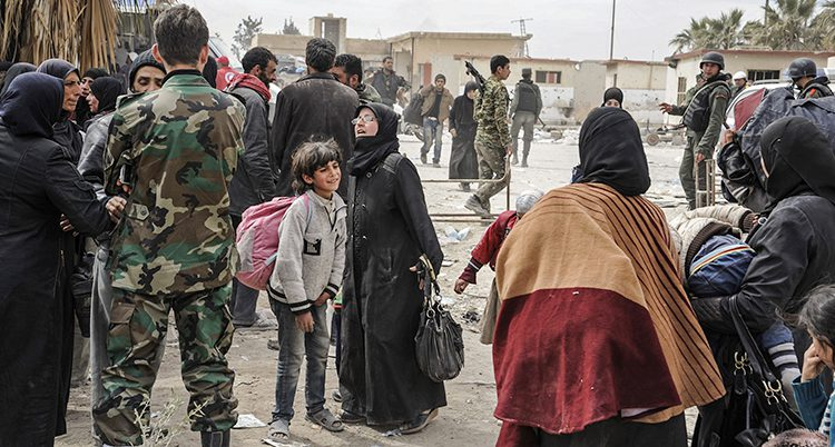 Människor i Ghouta i Syrien