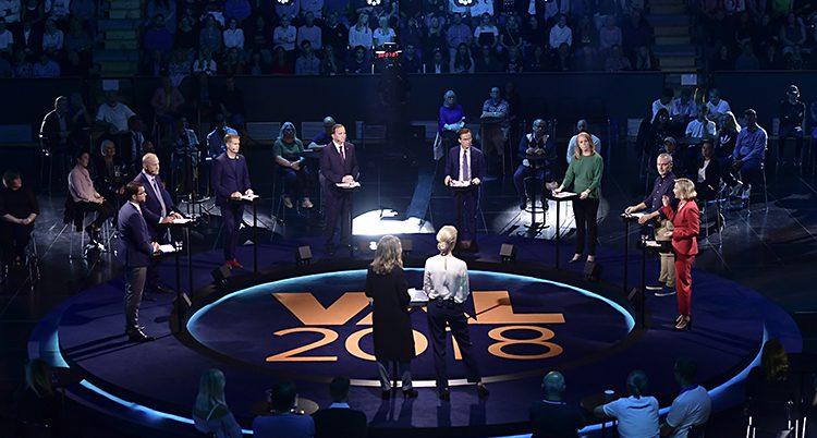 En bild på en debatt i tv.