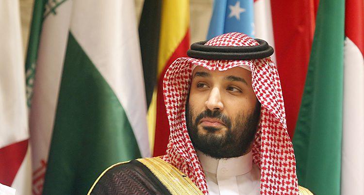 Ett porträtt på Mohammed bin Salman som tittar åt sidan och ser lite sur ut.