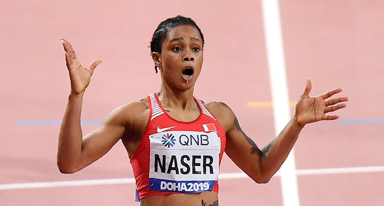 Salwa Eid Naser, of Bahrain, wins gold in the women's 400 meter final at the World Athletics Championships in Doha, Qatar, Thursday, Oct. 3, 2019. (AP Photo/Martin Meissner) ATH831 sträcker ut armarna. Hon ser förvånad ut.
