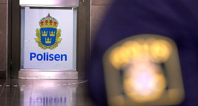 En bild på polisens logga.