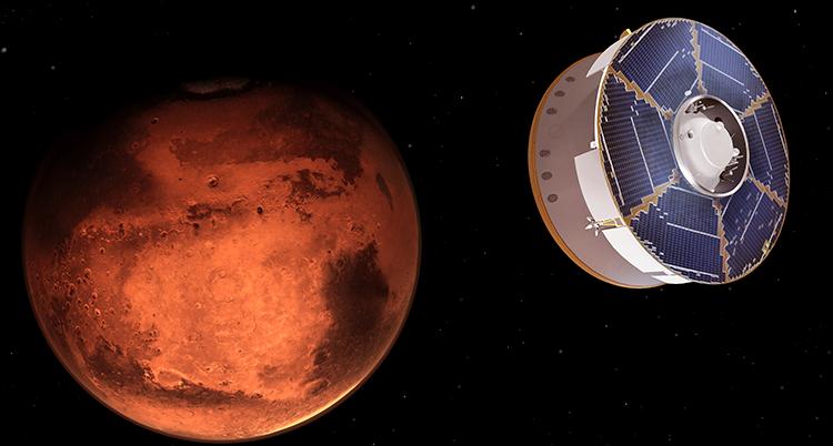 En röd planet ses i en svart rymd, en vit rymdsond är på väg mot planeten uppifrån höger